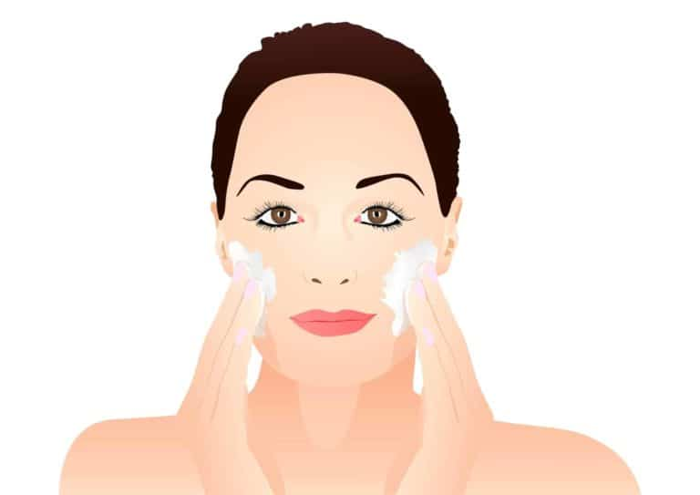 Woman Exfoliating Face Skin