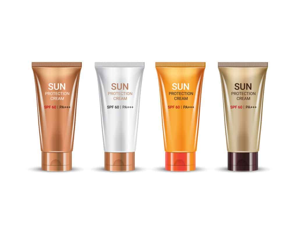 Tubes of sun protection cream on white background