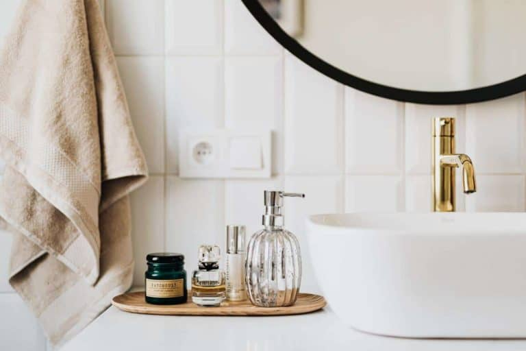 modern bathroom with a sink and skin care items