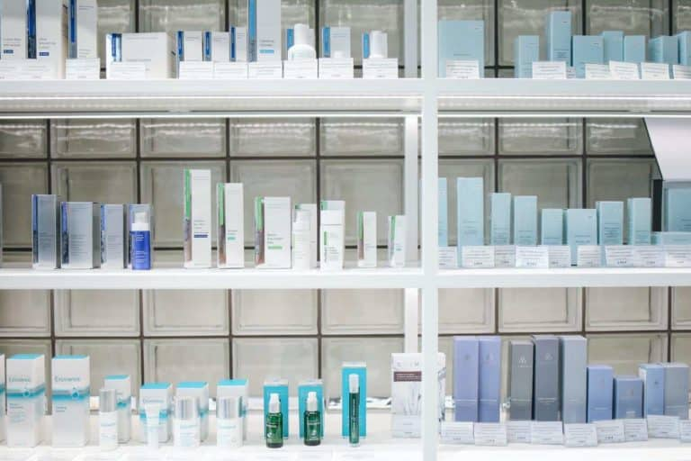 blue and white beauty products on three shelves
